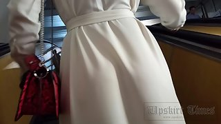 Ut_4524# Under the skirt of a tanned girl in a long white dress. Our cameraman managed to put his ha