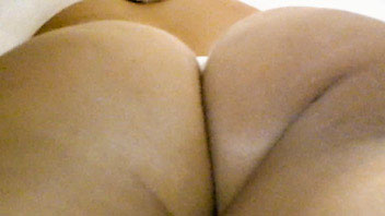 Ut_2522# Well-tanned blondie in short white dress. Our operator made shots of her exciting ass and s