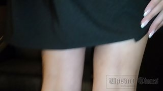 Ut_3328# A slender brunette in a short black skirt. Our cameraman kept her skirt up for a long time