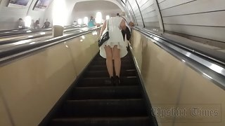 Ut_3639# For this beauty in a white dress I had to go up the escalator for a long time. She kept goi
