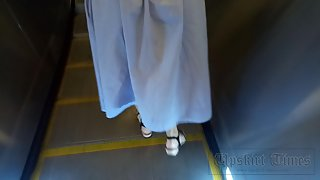 Ut_3970# Another beauty in a long dress, this time in blue. The girl looked at the smartphone and di
