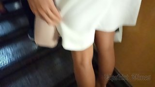 Ut_4063# This time we have a brunette in a white skirt and red sweater. Under a white skirt, white t
