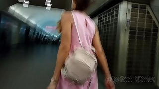 Ut_4046# Under the skirt of a tanned girl in a wide pink dress. The girl quickly climbed the stairs