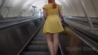 Ut_4575# Under the skirt of a girl in a short yellow dress. Our operator lifted her skirt several ti