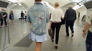 Ut_4109# Upskirt tanned brunette in a short blue skirt. Our cameraman filmed her tanned ass and shav
