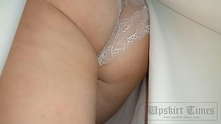 Ut_3686# A girl in a wide white skirt. Our cameraman filmed her hidden ass in white lace panties on