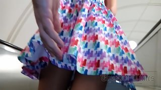 Ut_3315# A tanned beauty in a short colorful dress. Our cameraman kept her skirt up for a long time