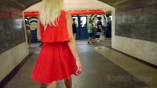 Ut_4085# Under the skirt of a tanned blonde in a short red dress. Our cameraman photographed on a sp