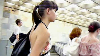 Ut_0878# A bronzed brunette in a short tunic! The girl was in a hurry, it was late and I had to catc
