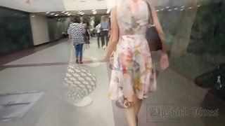 Ut_3515# The girl in the motley dress interested me in the subway car. On the escalator I began to t
