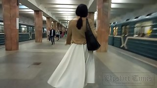 Ut_4395# Upskirt to tanned beauty in a wide white skirt. Our cameraman brazenly lifted her skirt and