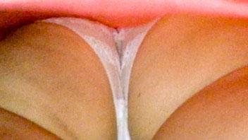 Ut_2631# Slender girl in red miniskirt. Our operator was raising her skirt few times. Ideal ass in w