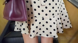 Ut_4574# Under the skirt of a tanned brunette in a short yellow polka-dot dress. Continuation of the