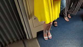 Ut_4153# Another short skirt, this time yellow. The girl carefully held the hem with her hand, but t