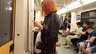 Ut_4375# Fiery redhead beauty in a skirt with a slit. I admired her in the train car and followed he