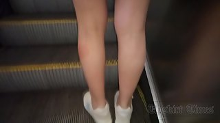 Ut_3784# Under the skirt of a brunette in a short black dress. Our cameraman held her skirt up for a