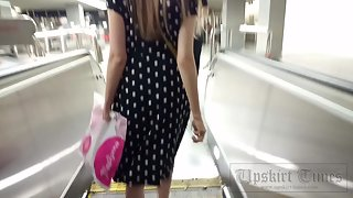 Ut_4230# Under the skirt of a slender girl in a black dress. Our cameraman brazenly lifted her skirt