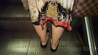 Ut_4248# This blonde in a colorful slit skirt, I could not miss. I managed to gently lift the hem an