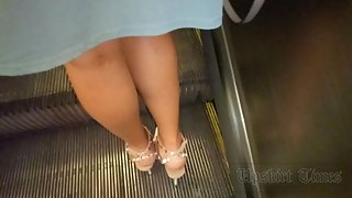 Ut_3930# A tanned girl in a short blue dress. Our cameraman held her skirt up for a long time and ca