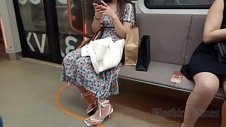 Ut_4666# The girl in a long multi-colored dress. Our operator lifted her skirt several times. Beauti