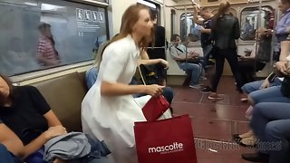 Ut_4143# Upskirt tanned beauty in a long white skirt. On the escalator in the subway, you can find g