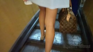 Ut_3786# Under the skirt of a tanned blonde in a short blue dress. Our upskirt master could not miss