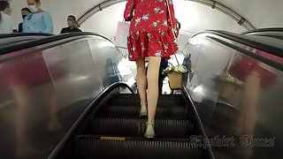 Ut_4576# Under the skirt of a slender girl in a short red dress. Rare upskirt footage in motion. Our